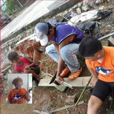 Watching Manong Raniel make a bamboo pop gun